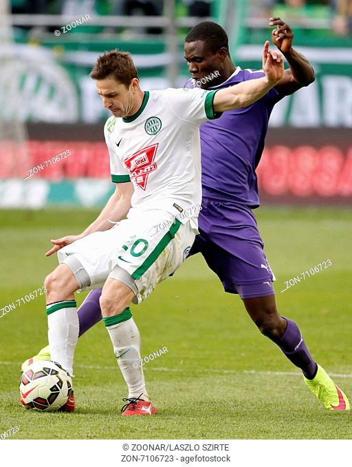 BUDAPEST, HUNGARY - APRIL 12, 2015: Duel between Zoltan Gera of Ferencvaros (l) and Kim Ojo of Ujpest during Ferencvaros vs
