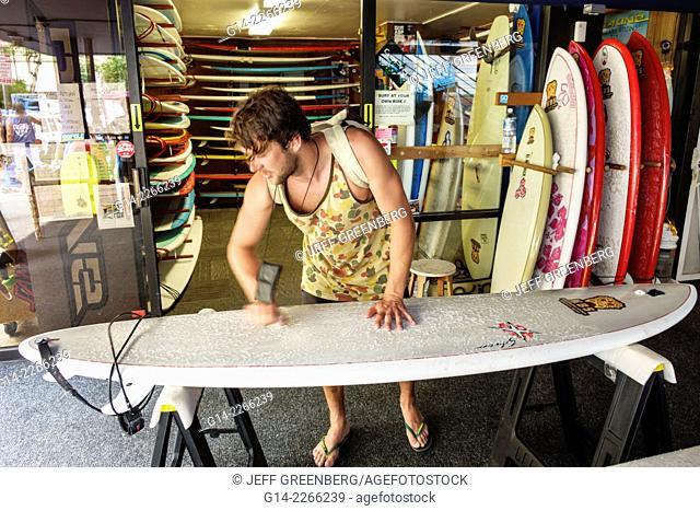Hawaii, Hawaiian, Oahu, Honolulu, Waikiki Beach, Kings Village Shopping Center, shopping, surfboard shop, man, waxing, sale, rental