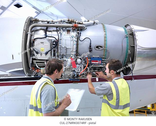 Engineers working on jet engine
