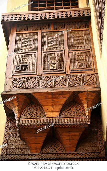 Islamic decorated wooden window called mashrabiya, at Bait el-harawi, an Arabic house, City of Cairo, Egypt