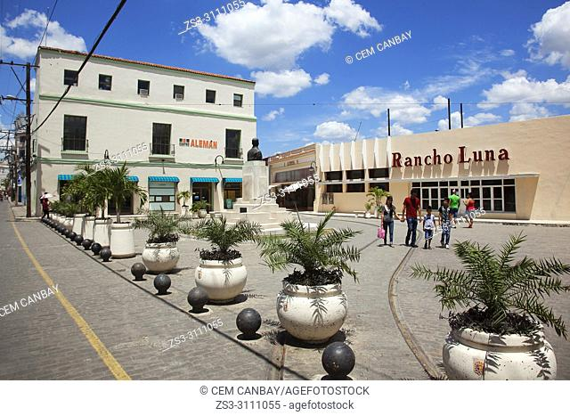 Local people in front of the shops in Plaza Maceo at the historic center, Camagüey, Cuba, West Indies, Central America