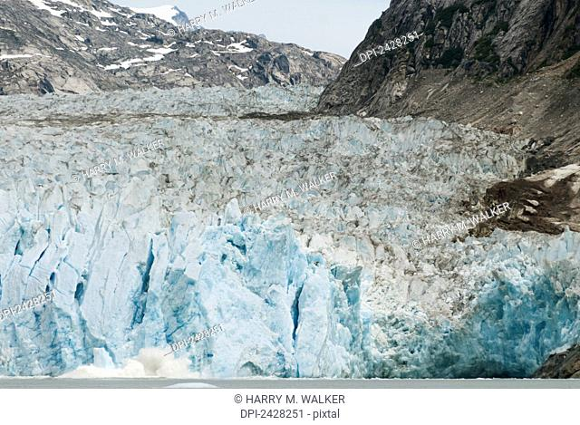 Dawes Glacier in Endicott Arm of Tracy Arm-Fords Terror Wilderness, a portion of the glacier calving visible; Alaska, United States of America