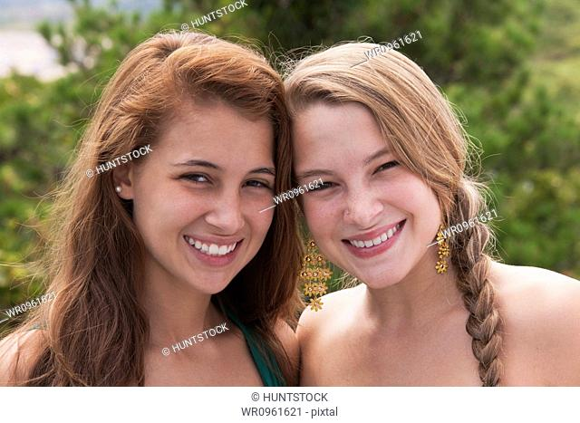 Portrait of two sisters smiling together, Block Island, Rhode Island, USA