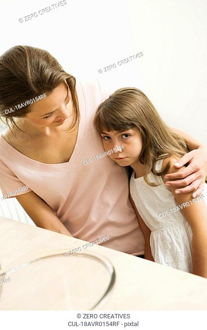 Sad little girl with her mother