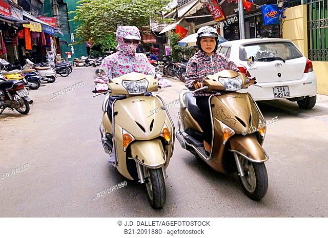 Vietnam. Hanoi. Motorcyclists with pollution protector