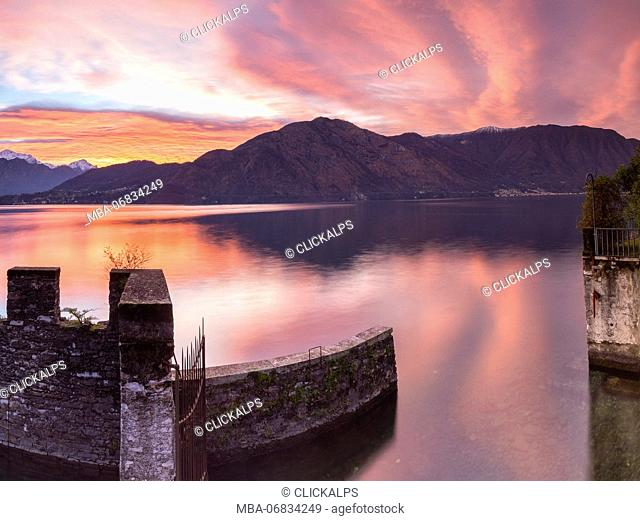 Dawn on Lake Como from the old boathouse in Tremezzina, in background mount Nuvolone Como Lake, Lombardy Italy. europe