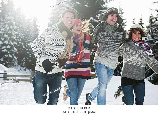 Austria, Salzburg Country, Flachau, Young people having fun in snow