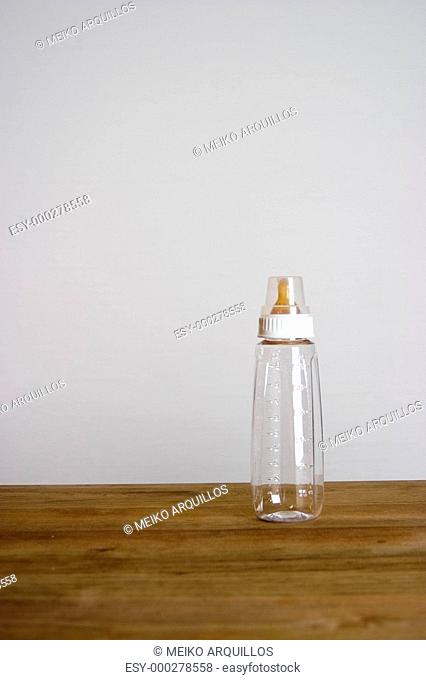Capped baby bottle