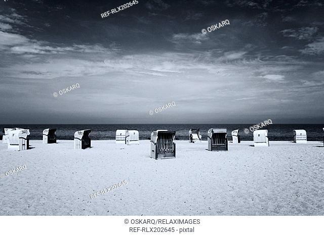 Row covered beach chairs basket black white wicker