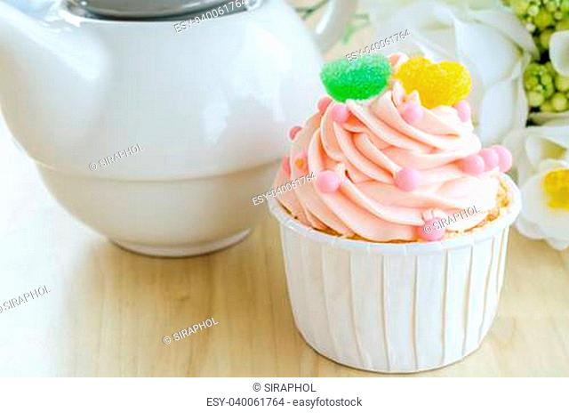 Strawberry cupcake on wood table