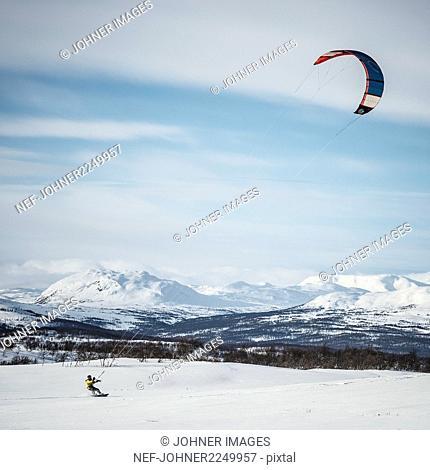 Kiteboarder in mountains