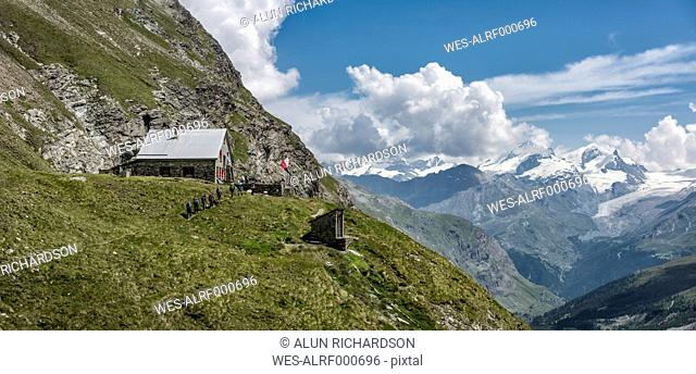 Switzerland, Hikers at Schonbiel hut