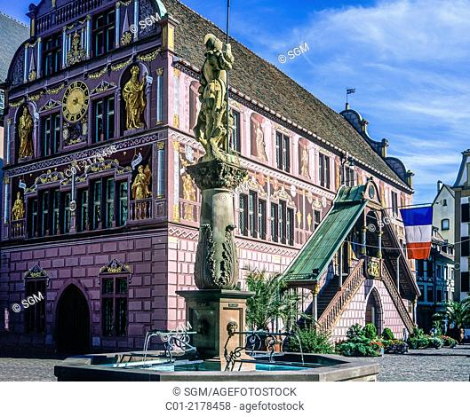 Fountain with halberdier statue and Renaissance former city hall 16th Century Mulhouse Alsace France