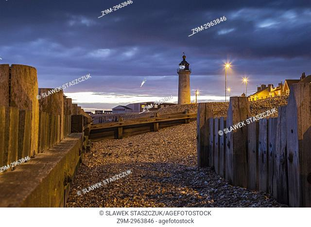 Night falls at Kingston Lighthouse in Shoreham-by-Sea, West Sussex, England