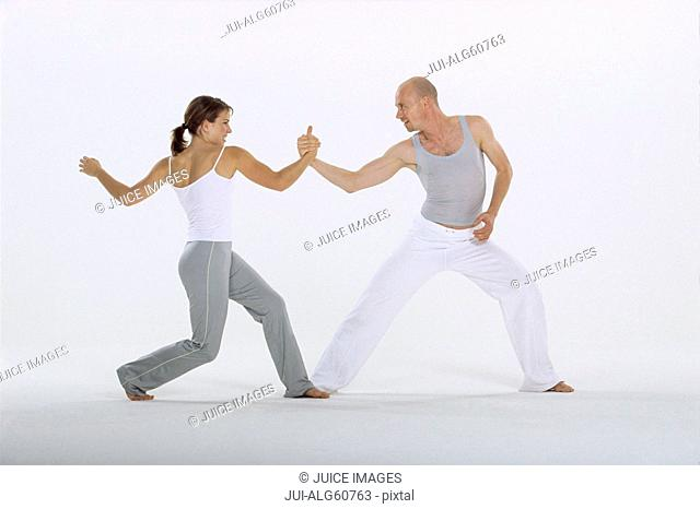 Male and female dancers balancing together