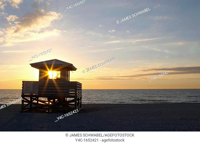SUNSET OVER GULF OF MEXICO AT VENICE BEACH IN VENICE FLORIDA