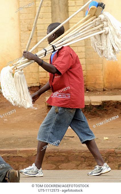 street scene with broom hawker in lilongwe malawi