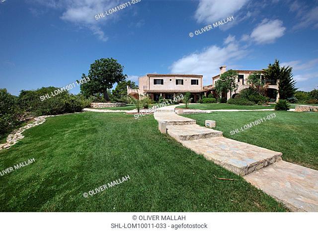 Sidewalk leading to Spanish style home