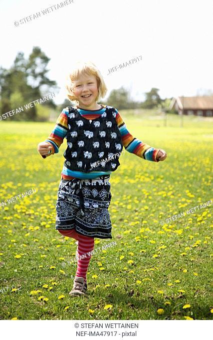 A girl standing on one leg, Varmdo, Sweden