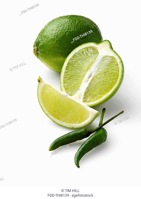 Limes and chillies on a white background
