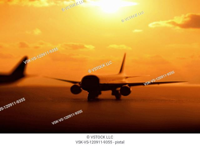 USA, Illinois, Metamora, Airplanes on runway at sunset