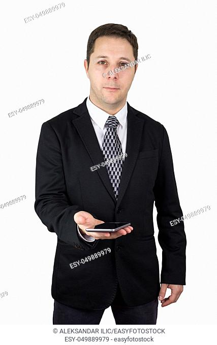 Businessman in Black Suit Holding Smartphone in Hand Against White Background