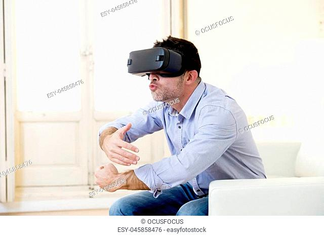 young man at home living room sofa couch excited using 3d goggles watching 360 virtual reality vision enjoying as if kissing virtual woman brest in cyber sex...