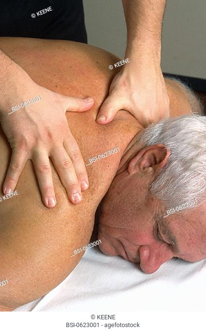 ELDERLY PERSON BEING MASSAGED<BR>Photo essay.<BR>Patient and Physiotherapist