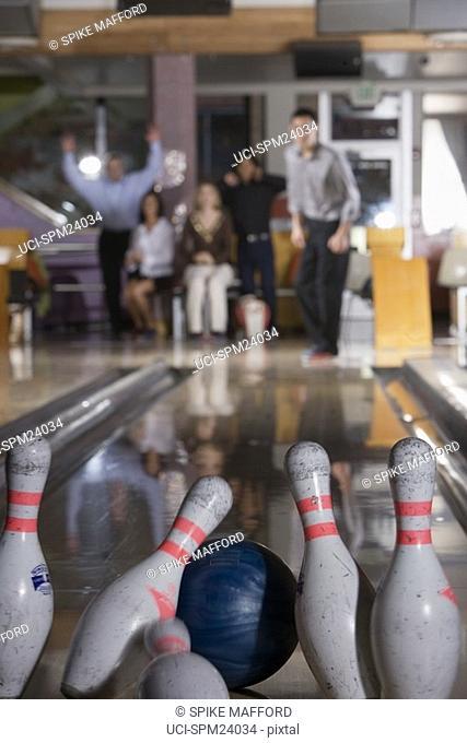 Man throwing bowling ball and making strike