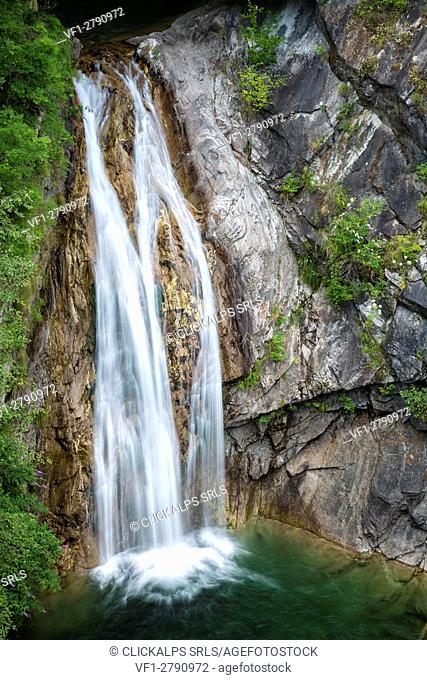 A waterfall in Messasca under the old road to Bognanco, Val Bognanco, Piedmont, Italy