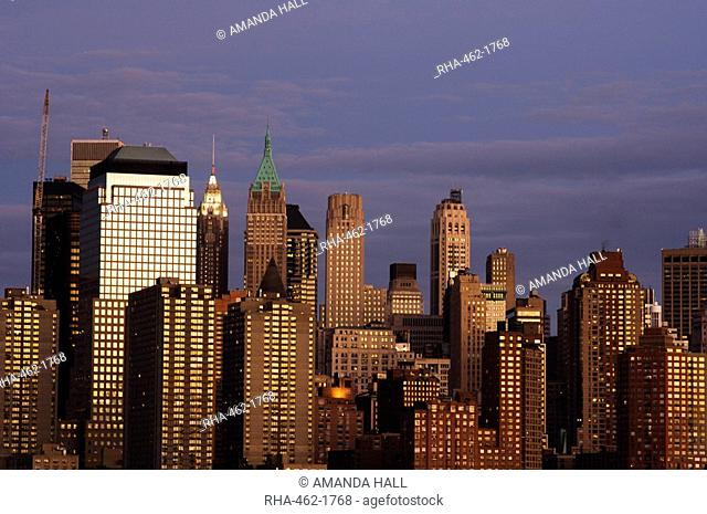 Lower Manhattan skyline across the Hudson River at dusk, New York City, New York, United States of America, North America