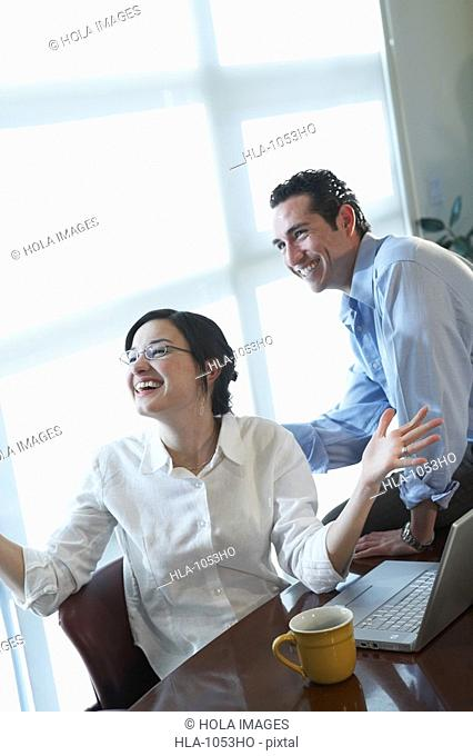 Businessman and a businesswoman smiling