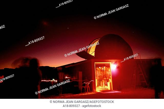 Young visitors at a star gazing party at the Vega-Bray Observatory in Benson, Arizona, USA, look through telescopes at dusk