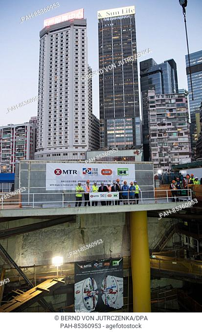 German Minister of Economic Affairs Sigmar Gabriel (SPD, R) inspects the building site where a tunnel is currently being constructed by Herrenknecht in Hong...