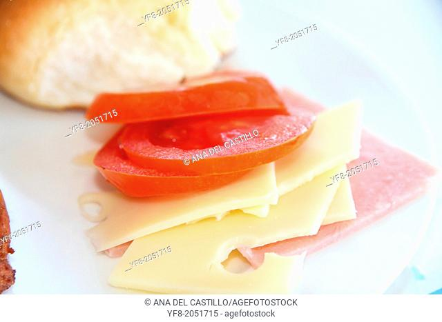 Fresh tomato slices of cheese and ham sandwich