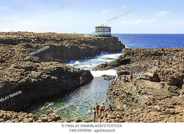Natural swimming pool in the rocks at Baracona, on the west coast nearTerra Boa, Sal, Salinas, Cape Verde, Africa. A popular spot for tourists