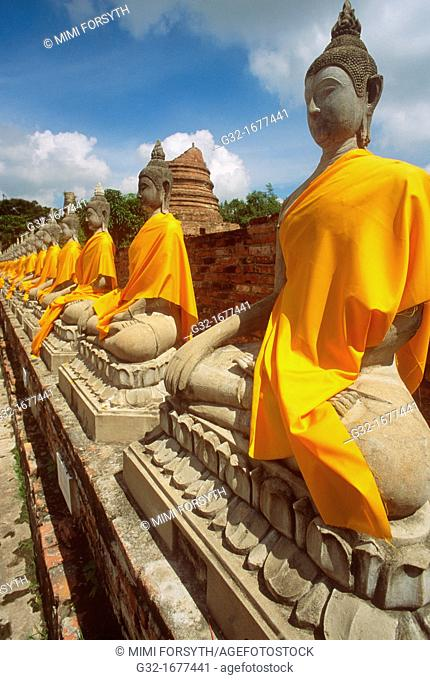 Buddhas at Ayutthaya, Thailand, wrapped in gold cloth on the occasion of the eve of Buddha's birth