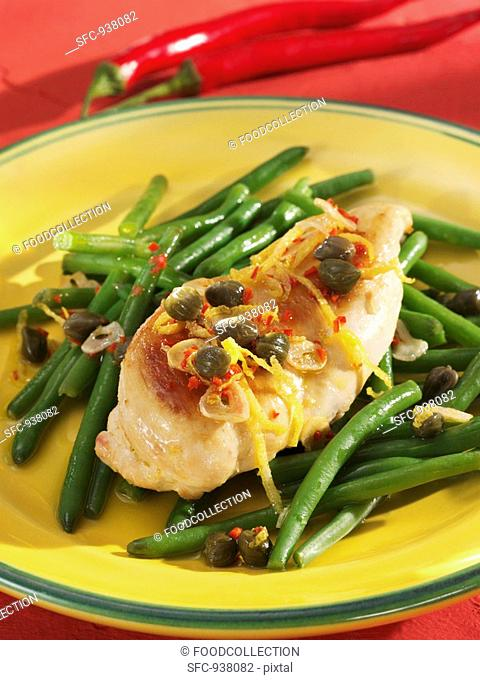 Chicken breast with garlic and chilli on green beans