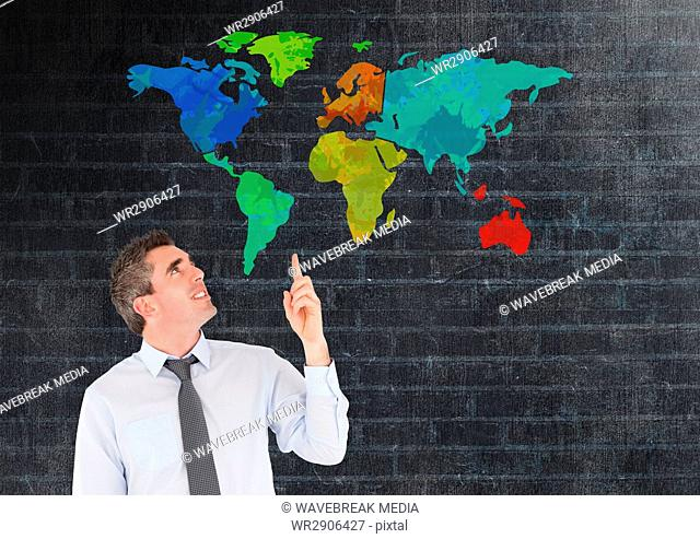 Man pointing at Colorful Map with wall background