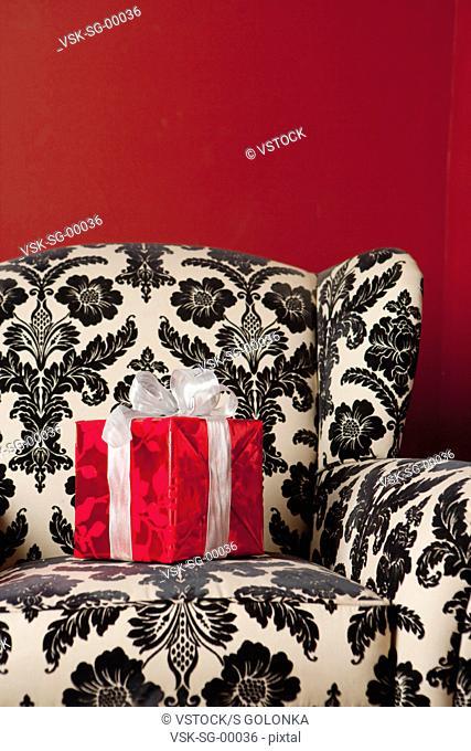 USA, California, La Quinta, Transparent Christmas present on sofa