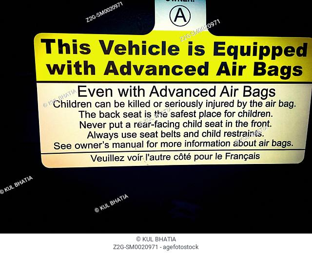 Air Bags warning in a new car, Canada