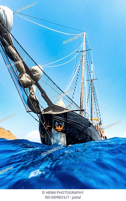 Bow of schooner sailboat from water surface level, Komodo Island, East Nusa Tenggara, Indonesia