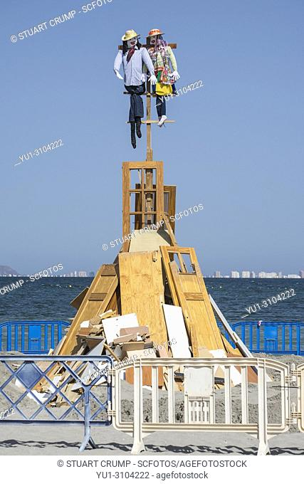 Figures on top of the bonfire on the beach at Los Alcazares to celebrate the fiesta of San Juan, Murcia Spain
