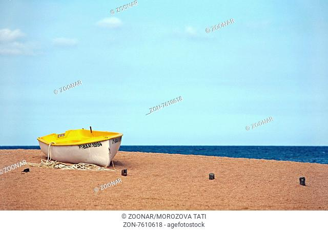 Lonely the boat on seacoast. Spain. Tossa