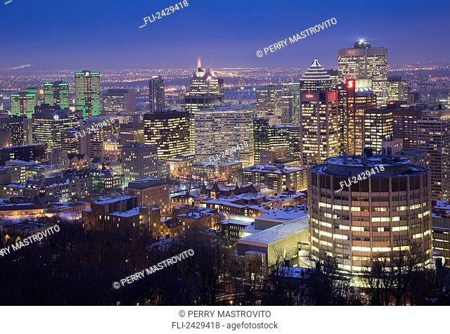City skyline at dusk in winter from Mount Royal lookout; Montreal, Quebec, Canada