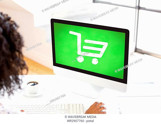 Person using Computer with Shopping trolley icon