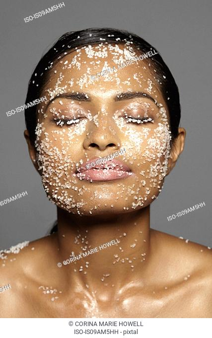 Female model's face covered in sugar
