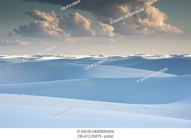 Clouds over tranquil white sand dunes, White Sands, New Mexico, United States