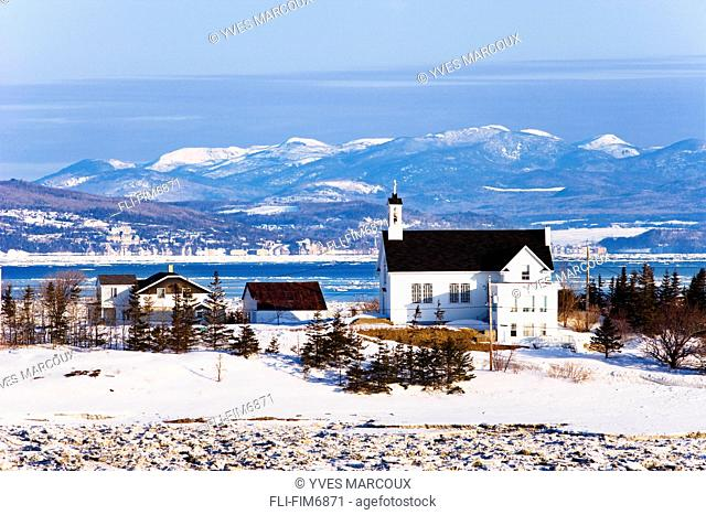 Artist's Choice: Church, St. Lawrence River and mountains of Charlevoix region at sunrise, Bas-Saint-Laurent region, Riviere-Ouelle, Quebec