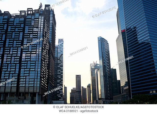 Singapore, Republic of Singapore, Asia - Modern skyscrapers are lining up along Singapore's business district in Marina Bay with the Marina One on the left